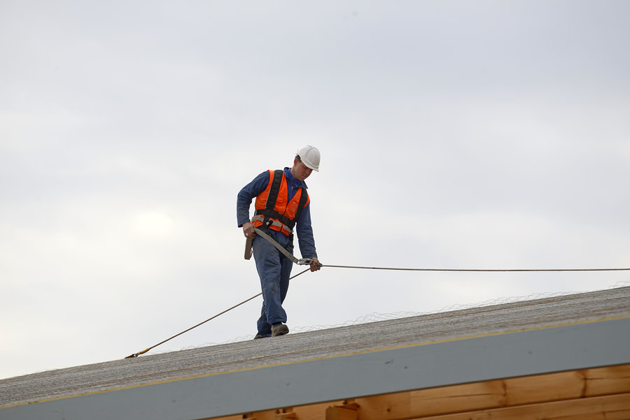 A roofer is maintaining a residential roof